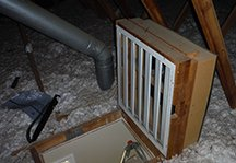 home inspection find - fold up whole house attic fan at the attic access hatch